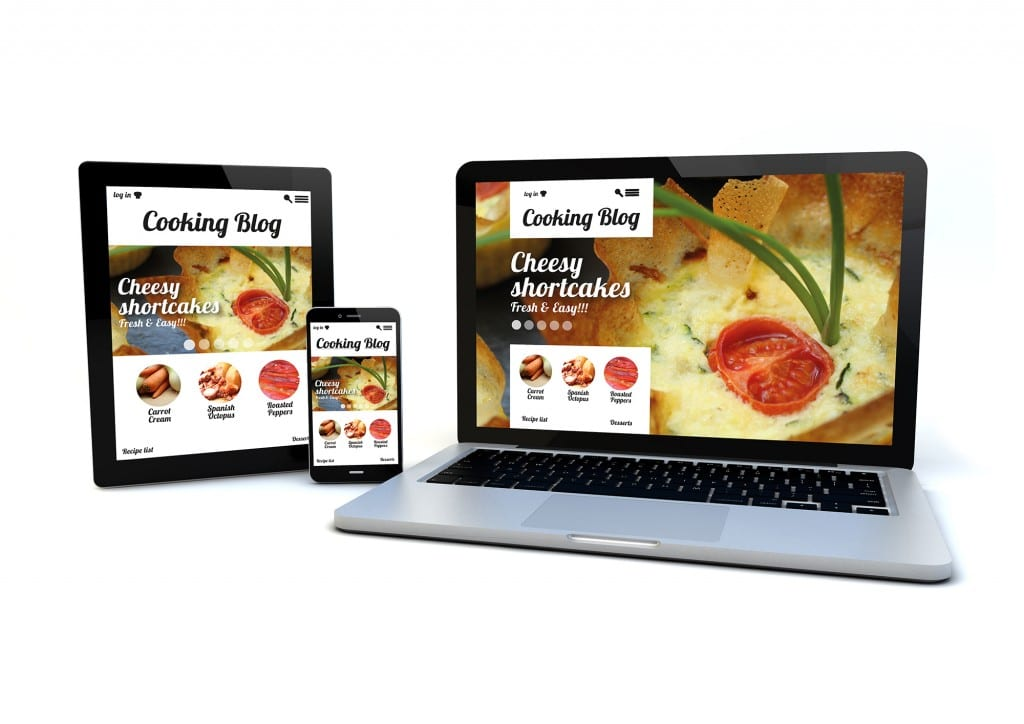 render of an smartphone, a tablet pc and a computer with a responsive design cooking blog on the screen